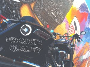 promote-quality-imagery-and-content-by-focusing-on-your-customers-needs-pictured-is-a-black-harley-dyna-swithcback-in-downtown-phoenix-next-to-some-wall-art