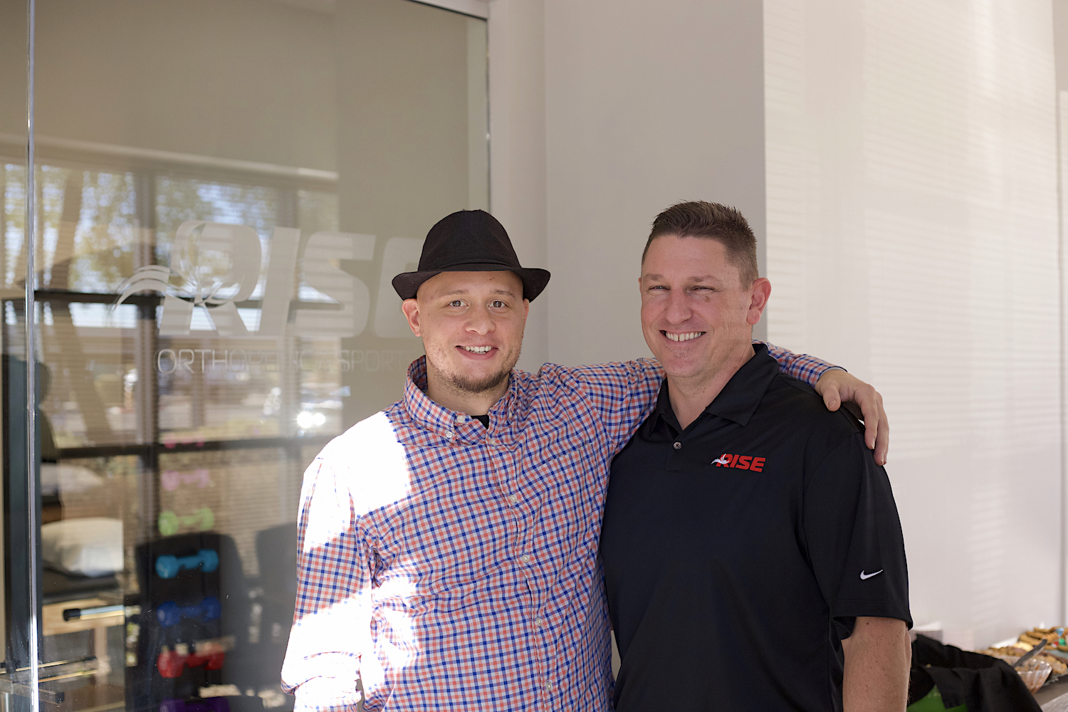 brand-development-services-in-west-phoenix-during-launch-of-rise-orthopedic-and-sports-pt-in-surprise-az-picture-of-jordan-trask-with-client-and-owner-mark-jagodzinski
