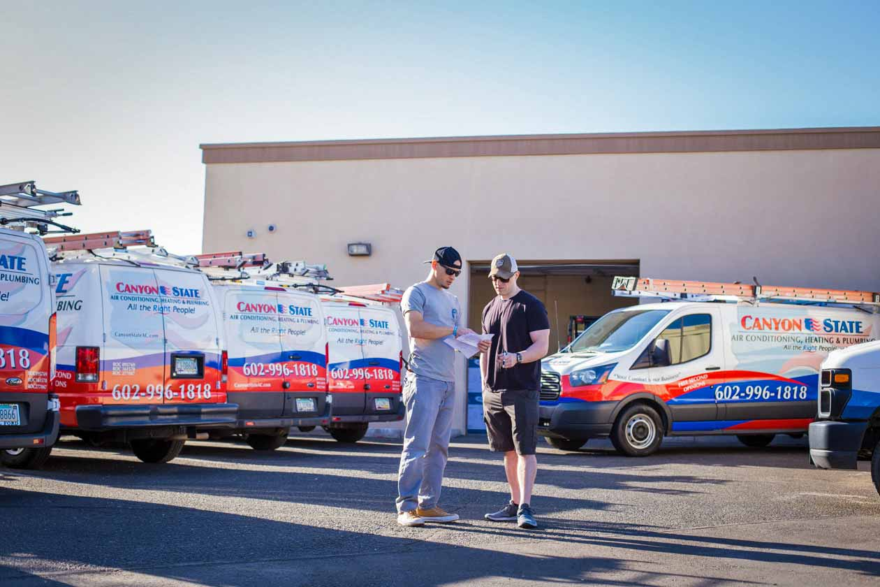 jordan-trask-from-prefocus-solutions-discussing-brand-development-services-with-partner-nathan-seeley-of-bluesoft-websites-during-corporate-photoshoot-for-phoenix-local-hvac-company-in-sun-city-west